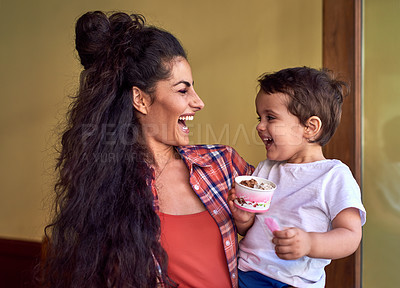 Buy stock photo Cropped shot of an attractive young woman and her young son at an ice cream shop