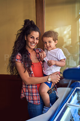 Buy stock photo Cropped portrait of an attractive young woman and her young son at an ice cream shop