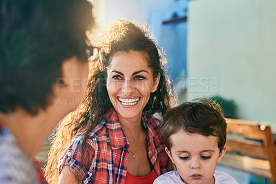 Buy stock photo Cropped shot of an attractive young woman and her son visiting her mature mother