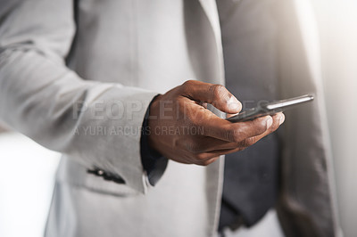 Buy stock photo Closeup shot of an unrecognizable businessman using a cellphone