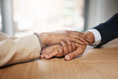 Buy stock photo Closeup shot of two unrecognizable businesspeople holding hands in an office