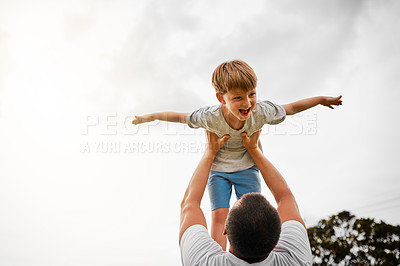 Buy stock photo Cropped shot of a mature man lifting his young son high into the air outside