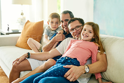 Buy stock photo Cropped portrait of an affectionate family of four on the sofa at home
