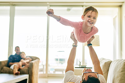 Buy stock photo Cropped portrait of an adorable little girl playing with her father at home