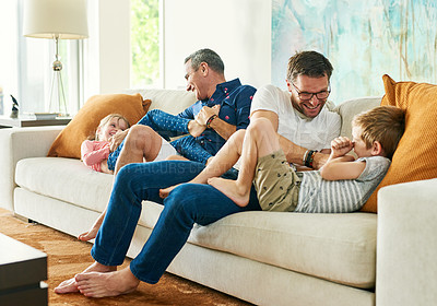 Buy stock photo Full length shot of an affectionate family of four on the sofa at home