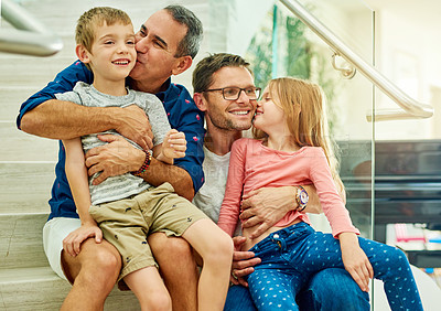Buy stock photo Cropped shot of an affectionate family of four on the stairs at home