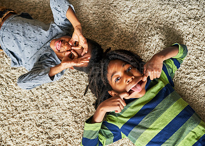 Buy stock photo High angle shot of two little boys pulling funny faces