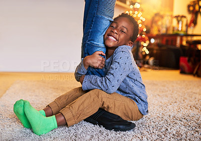 Buy stock photo Shot of a little boy holding on to his father's legs