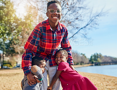Buy stock photo Portrait of three adorable siblings having fun together outdoors