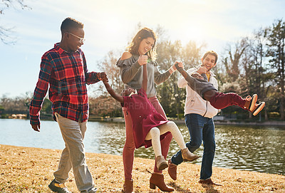 Buy stock photo Shot of a happy family having fun together outdoors
