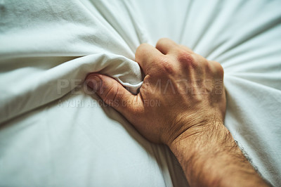 Buy stock photo Closeup shot of an unrecognizable man's hand grabbing a sheet in pleasure