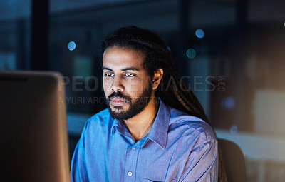 Buy stock photo Shot of a young designer working late in an office
