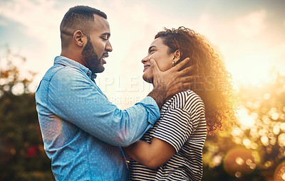 Buy stock photo Shot of an affectionate young couple in the park