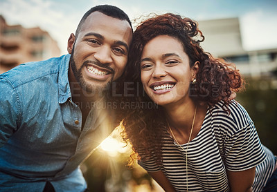 Buy stock photo Portrait of a happy young couple enjoying a day in the park