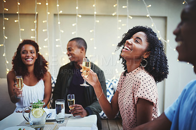 Buy stock photo Cropped shot of a group of young friends enjoying a night out