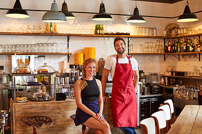 Buy stock photo Shot of a confident man and woman working together in a coffee shop