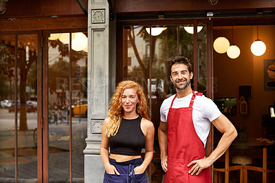 Buy stock photo Shot of co-owners standing outside their coffee shop