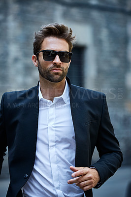 Buy stock photo Cropped shot of a handsome young businessman running through an urban alleyway