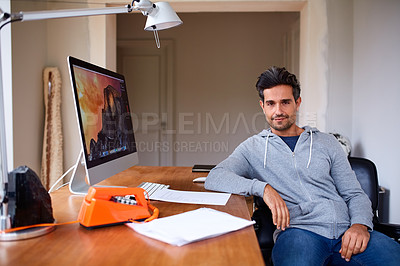 Buy stock photo Portrait of a handsome young man working from his home office