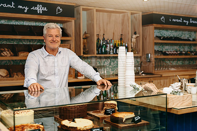 Buy stock photo Cropped portrait of mature male entrepreneur standing in his self-owned coffee shop