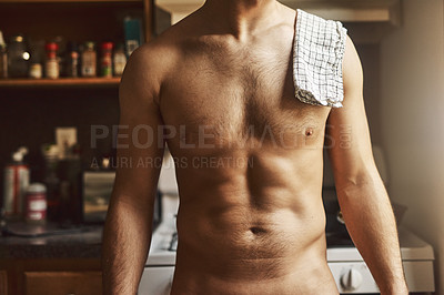 Buy stock photo Cropped shot of an unrecognizable shirtless man in the kitchen at home