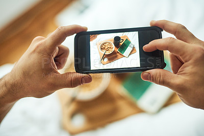 Buy stock photo High angle shot of an unrecognizable man taking a picture of his breakfast in bed at home