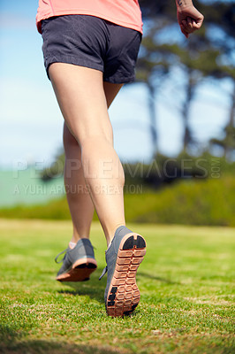 Buy stock photo Rearview shot of an unrecognizable woman running outside