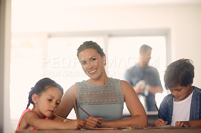 Buy stock photo Shot of a woman bonding with her children