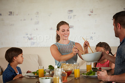 Buy stock photo Shot of a family of four having supper at home