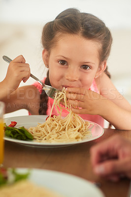 Buy stock photo Cropped shot of an adorable little girl eating her food at home