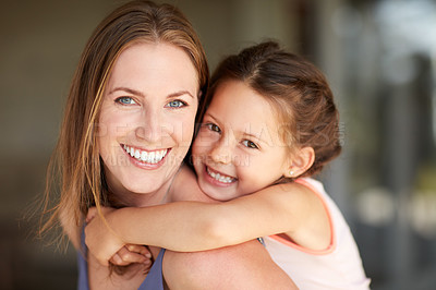Buy stock photo Cropped shot of a mother and daughter spending time together at home