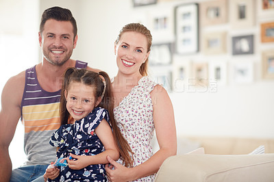 Buy stock photo Shot of a family of three spending quality time together at home