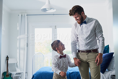 Buy stock photo Cropped shot of an adorable little boy and his father dressed in matching outfits