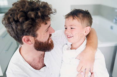Buy stock photo Cropped shot of a young handsome father drying his adorable little son after a bath in the bathroom at home