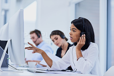 Buy stock photo Shot of a confident young woman working in a call center