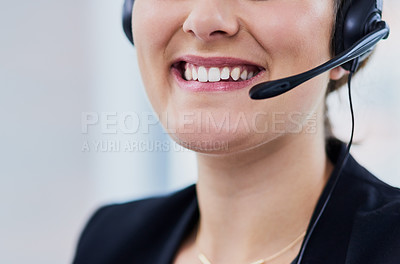 Buy stock photo Cropped shot of a smiling young woman working in a call center