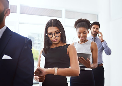 Buy stock photo Shot of a group of young businesspeople standing in line in a modern office