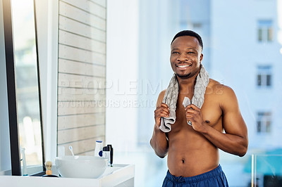 Buy stock photo Portrait of a cheerful young man going through his morning grooming routine at home