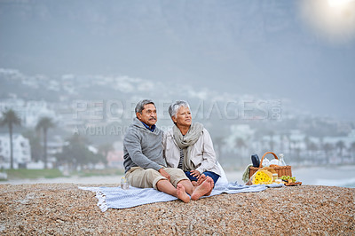 Buy stock photo Shot of a loving mature couple spending the day at the beach