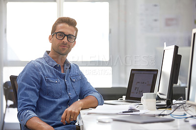Buy stock photo Shot of a handsome young man working in an office