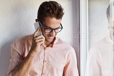 Buy stock photo Shot of a young businessman talking on his cellphone