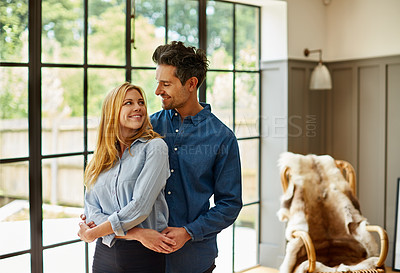 Buy stock photo Shot of an affectionate couple bonding together at home