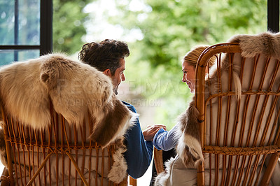 Buy stock photo Rearview shot of a couple relaxing together on rocking chairs at home