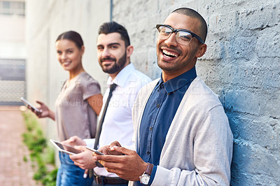 Buy stock photo Portrait of a group of businesspeople using digital devices outdoors