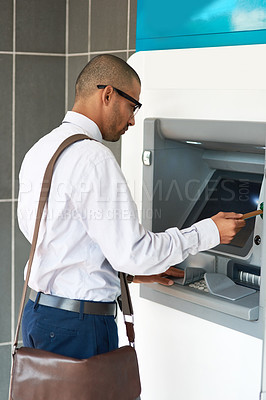Buy stock photo Shot of a businessman making a transaction at an ATM
