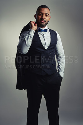 Buy stock photo Cropped portrait of a handsome young businessman standing with his hand in his pocket against a gray background