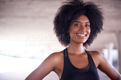 Buy stock photo Cropped portrait of an attractive and athletic young woman exercising out in the city