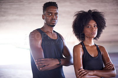 Buy stock photo Cropped portrait of two young sportspeople standing with their arms crossed while working out in the city