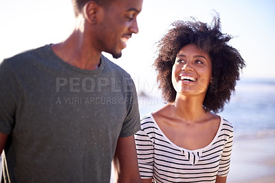 Buy stock photo Cropped shot of a young attractive couple spending time together at the beach