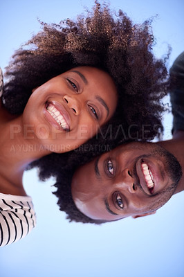 Buy stock photo Low angle shot of a young attractive couple spending time together at the beach